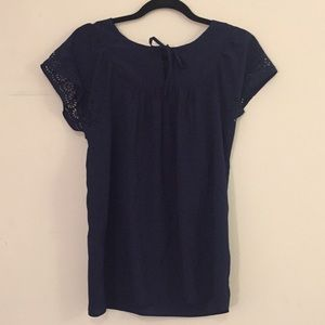 Navy blue top with laser cut floral shortsleeves